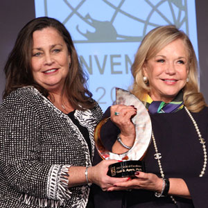 CEO Wendy Mann awards the 2017 CREW Network Circle of Excellence award to Gail Ayers