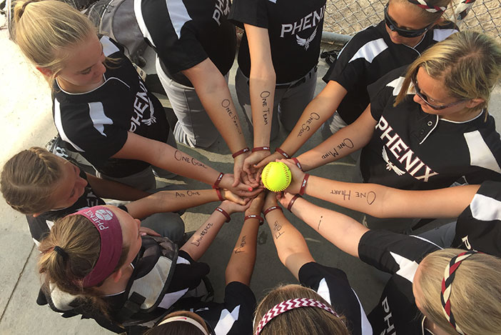 Softball team huddle